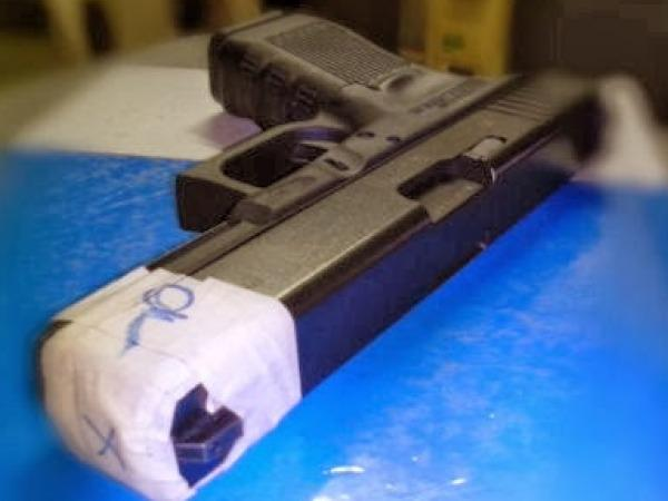 pnp-standard-issue-glock-17-generation-4-pistol-with-the-muzzle-wrapped-with-masking-tape-410.jpg